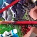 Fondant artists' palette decorated with coloured royal icing 'paint' and fondant paintbrushes.