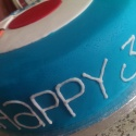 Text around the outside of the cake - 'Happy 30th Birthday'