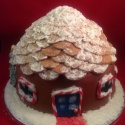 The body of the house was made from Christmas cake and the roof from sponge