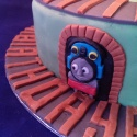 Bright blue Victoria Sponge inside this Thomas the Tank Engine Cake