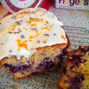 Blueberry and Apple loaf decorated with white icing, orange peel and lavender flowers