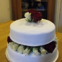 Simple wedding cake decorated with beautiful roses