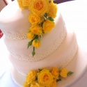 Lemon sponge iced cake decorated with pastel ribbon and lace