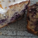 Blueberry and apple loaf sprinkled with lavender flowers and grated orange zest.