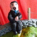 A fondant husband sitting on the dry-stone wall waiting for a fondant me...